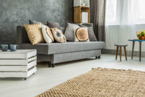 Grey sofa with pillows | Pink Shoe Cleaning Crew | House Cleaning Omaha