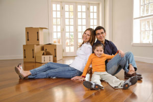 Man, woman and child sitting on floor- moving in or moving out of their home | Pink Shoe Cleaning Crew | House Cleaning in Greater Omaha