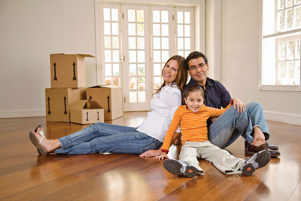 Man, woman and child sitting on floor- moving in or moving out of their home | Pink Shoe Cleaning Crew | House Cleaning Omaha