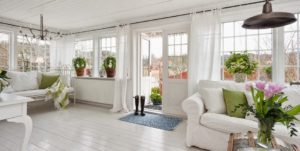 White Sun room with sofa and open door to outside | Pink Shoe Cleaning Crew | House Cleaning in Greater Omaha