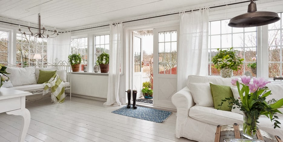 White Sun room with sofa and open door to outside | Pink Shoe Cleaning Crew | House Cleaning Omaha