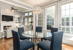 Dining / Living Room facing glass windows and door leading to deck. | Pink Shoe Cleaning Crew | House Cleaning Omaha