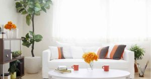 White sofa with pillows and shelving unit | Pink Shoe Cleaning Crew | House Cleaning Omaha