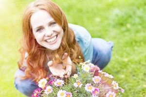 Woman with a spring floral arrangement