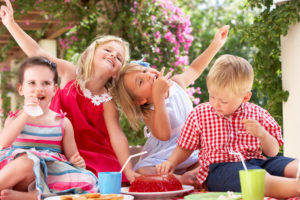 four children on a picnic table